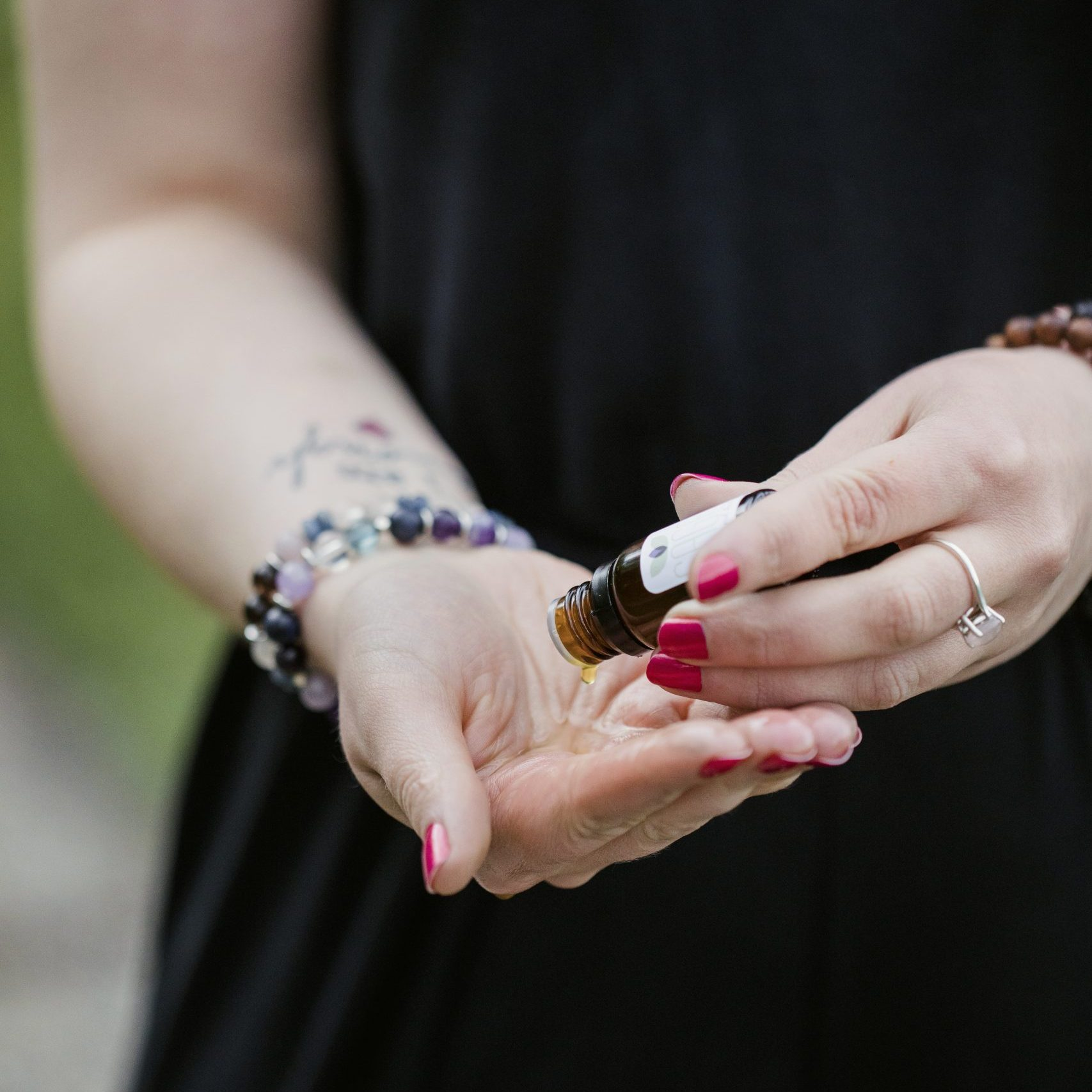 person applying essential oils to their palm